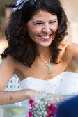 Happy young bride laughing — Stock Photo