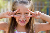 Funny little girl on the playground — Stock Photo