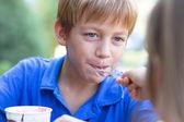 Little boy eating ice-cream — Stock Photo