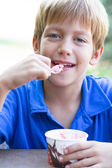 Funny little boy eats ice-cream — Stock Photo