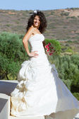 Happy young bride in dress — Stock Photo