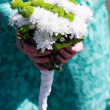 Bridesmaid holding a wedding bouquet — Stock Photo