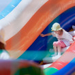 Little girls in a jumping castle — Stock Photo