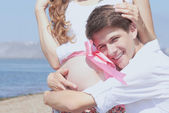 Happy young husband and his pregnant wife — Stock Photo