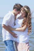 Happy pregnant girl and her loving husband — Stock Photo