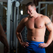 Pumped men in the gym - Stock Photo