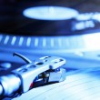Turntable playing vinyl record with music — Stock Photo