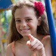 Llittle girl pointing a finger at you — Stock Photo