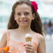 Happy little girl with ice cream in hand — Stock Photo