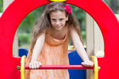 Cute little girl on the playground — Stock Photo