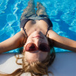 Stock Photo: Blond girl chilling in pool