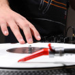 Hip-hop dj scratching record with music — Stock Photo