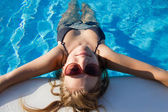 Blond girl chilling in the pool — Stock Photo