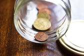 Stash of Greek euro coins in a jar — Stock Photo