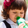 Small girl drinking water from bottle — Stock Photo