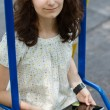 Teenage girl with tablet pc on a swing — Stock Photo #28476085