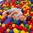 Little girl playing in inflatable bouncing castle — Stock Photo #28476243