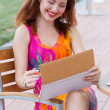Young lady planning in her organizer — Stock Photo