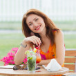 Sexy young woman drinking coctail — Stock Photo
