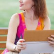 Young lady planning in her organizer — Stock Photo #29847507