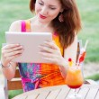 Young girl browsing trendy tablet pc — Stock Photo #29848023