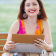 Young lady planning in her organizer — Stock Photo #29849057