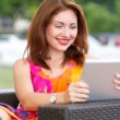 Young girl browsing trendy tablet pc — Stock Photo