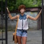 Teen hipster girl posing outdoors — Stock Photo #29866459