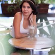 Foto de Stock  : Attractive brunette girl in cafe outdoors