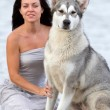 Young woman with alaskan malamute dog — Stock Photo #30453215