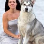 Young woman with alaskan malamute dog — Stock Photo