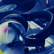 Постер, плакат: DJ headphones on sound mixer