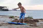 Little boy learning how to surf — Stock Photo