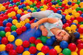 Little girl playing in inflatable bouncing castle — Stock Photo