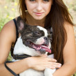 Pretty young lady holding her bulldog — Foto Stock