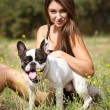 Pretty young girl with her dog — Stock Photo
