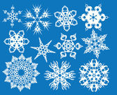 Blaue reihe von schneeflocken — Stockvektor