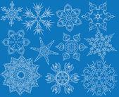 Conjunto azul de copos de nieve — Vector de stock