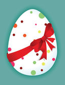 Funny egg with a red bow — Stockvektor