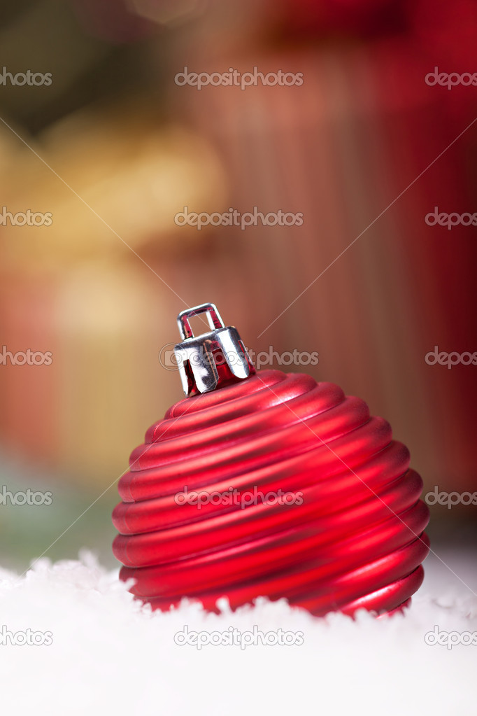 Chrismas red ball against giftboxes — Stock Photo #15725509