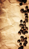 Coffee beans on a crumpled paper texture background — Stock Photo