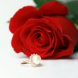 Ring with pearl and red rose — Stock Photo #2180728