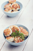 Meatballs in blue bowls on table — Stock Photo