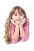 Curly smiling girl lies on a floor — Stock Photo