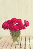 Vintage image of red roses bouqet outdoor — Stock Photo