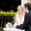 Stock Photo: Bride and groom at outdoor cafe