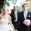 Bride and groom having a walk — Stock Photo
