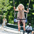 Stock Photo: Swinging preschooler girl