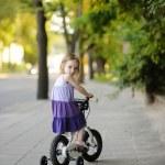 Little girl riding a bike — Stock Photo