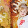 Little girl in front of colorful wall — Stock Photo #13725088